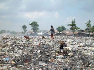 Person walking through ewaste landfill
