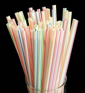 plastic straws in a drinking glass