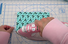 Step 7 use an iron to flatten the cloth