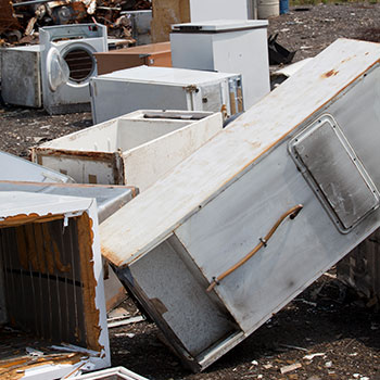 a landfill with old refrigerators and washing machines