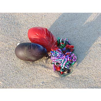 Balloons left as garbage in a beach