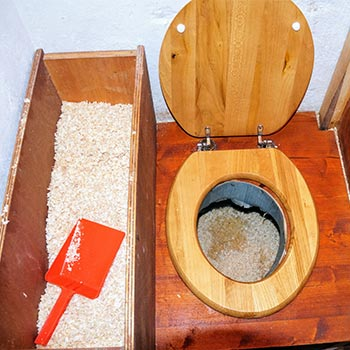 sawdust beside a wood toilet