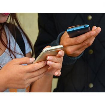 mobile phones in people's hands
