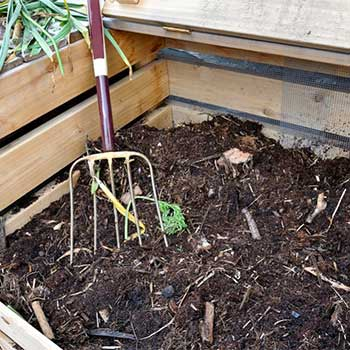 speed up the compost by rotating it