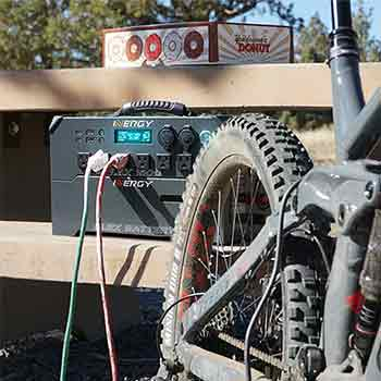 AC outlets on a generator with a bicycle in front