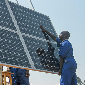 Solar panel being installed by a man