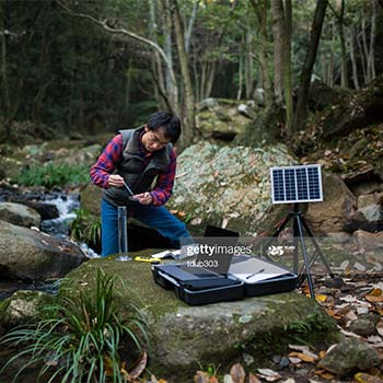 Samples being taken in the forest by a man with a solar panel