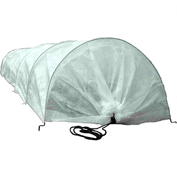 A white Tierra Garden Haxnicks Easy Fleece Tunnel Garden Cloche