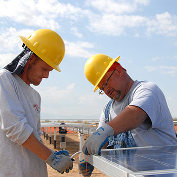 Solar panel being assembled by two men