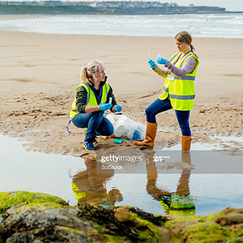 Lab samples being taken by two women at the beach