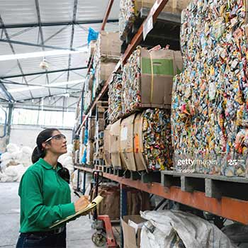 Woman inspecting materials to be recycled