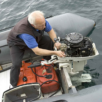 Environmental engineer who is male on a boat