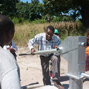 Water engineer who is male with a water pump