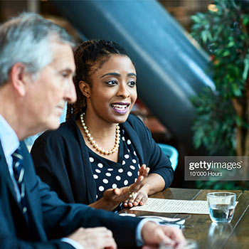 Corporate sustainability intern talking beside a man