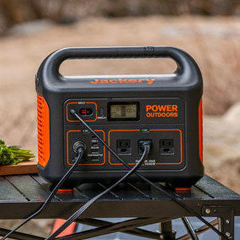 Table outdoors with a jackery explorer 1000 solar generator on it