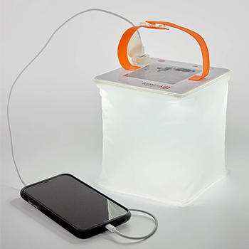 Luminaid Packlite Max 2-in-1 Phone Charger Solar Lantern on a gray background